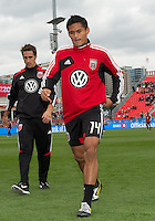 06 October 2012: D.C. United midfielder Andy Najar #14 coming off the pitch after warm-up in an MLS game between D.C. United and Toronto FC at BMO Field in Toronto, Ontario..D.C. United won 1-0..