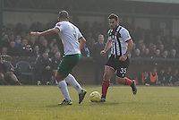 Pat Hoban of Grimsby Town takes on Sami El-Abd of Bognor Regis Town during the FA Trophy Semi Final first leg match between Bognor Regis and Grimsby Town at Nyewood Lane, Bognor Regis, England on 12 March 2016. Photo by Paul Paxford/PRiME Media Images.
