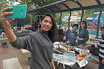 Indonesian domestic workers in Hong Kong take selfies as they gather to eat together in a public park on Sunday, their only day off. Some 370,000 foreign domestic workers live in Hong Kong, about five percent of the population. Most are women from the Philippines and Indonesia.