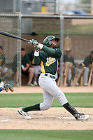 Jose Crisotomo #18 of the Oakland Athletics plays in an extended spring training game against the Chicago Cubs at the Athletics minor league complex on May 18, 2011  in Phoenix, Arizona. .Photo by:  Bill Mitchell/Four Seam Images.