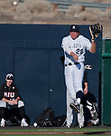 February 22, 2013: Nevada Wolf Pack third baseman Austin Byler leaps and make the throw against the Northern Illinois Huskies during their NCAA baseball game played at Peccole Park on Friday afternoon in Reno, Nevada.