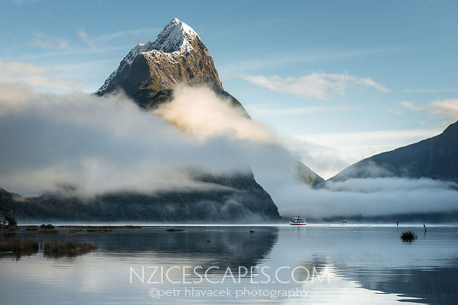 Winter morning in Milford Sound with Mitre Peak 1692m in background, Fiordland National Park, Southland, UNESCO World Heritage Area, New Zealand, NZ
