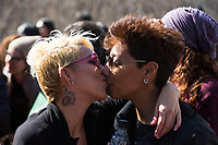NEW YORK, NEW YORK - MARCH 8:  Two women kiss and show their love during the women's strike in Washington Sq Park for Women's Day on March 8, 2020. in New York. 3,500 women were killed for gender reasons in 25 countries in Latin America and the Caribbean in 2019. UN said. (Photo by Pablo Monsalve / VIEWpress via Getty Images)