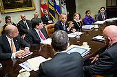 United States President Barack Obama speaks to the media during a meeting with his national security and public health teams concerning the government's Ebola response, in the Roosevelt Room of the White House, on November 18, 2014, in Washington, DC. Looking on, from left, Jeh Johnson, Secretary of Homeland Security, Ron Klain, Ebola Response Coordinator, Lisa Monaco, Homeland Security Advisor to President Obama, Susan Rice, National Security Advisor, and Tom Frieden, Director of the Centers for Disease Control and Prevention.President Obama called on Congress to approve $6.2 billion in emergency spending to fight Ebola in West Africa.  <br /> Credit: Drew Angerer / Pool via CNP