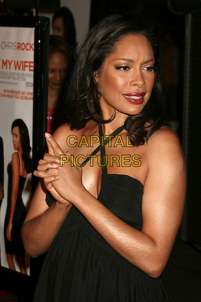 "GINA TORRES .""I Think I Love My Wife"" Los Angeles Premiere at ArcLight Cinemas, Hollywood, California, USA..March 7th, 2007.half length black halterneck dress hands gun funny .CAP/ADM/BP.©Byron Purvis/AdMedia/Capital Pictures"