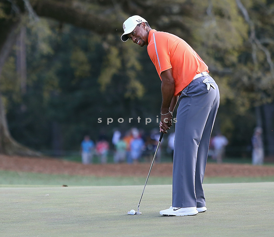 Tiger Woods plays golf during a 2013 Masters Tournament practice round at Augusta National Golf Club on April 8, 2013 in Augusta, Georgia. *** Local Caption *** Tiger Woods