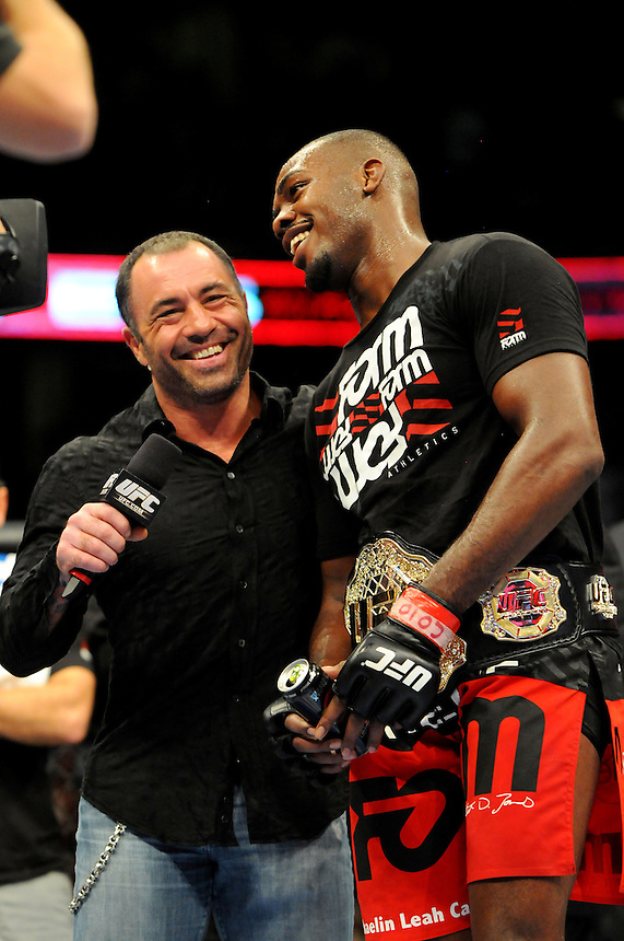 "24 SEPTEMBER 2011:    Jon ""Bones"" Jones celebrates his victory  against Quinton ""Rampage"" Jackson and talks to Joe Rogan during UFC 135 at the Pepsi Center in Denver, Colorado. *****For Editorial Use Only*****"
