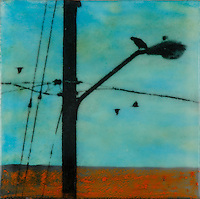 Mixed media photo transfer of crow on streetlamp with telephone lines over encaustic painting.