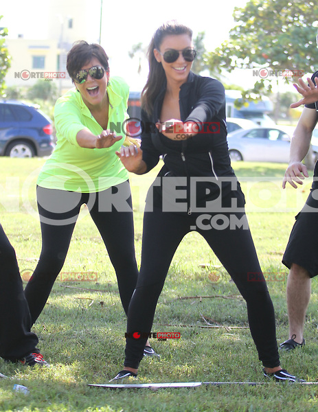 /NortePhoto /NortePhoto The Kardashian family was seen at a park doing stretches and practicing their rowing skills before heading out on boats in Miami, Florida .29.SEP.2012.MIAMI BEACH<br /> (OHPIX/NortePhoto)