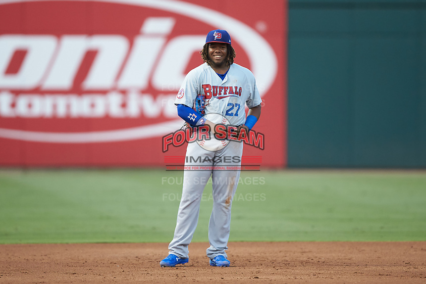 Buffalo Bison third baseman Vladimir Guerrero Jr. (47) smiles as he puts on a new belt during the game against the Charlotte Knights at BB&T BallPark on August 14, 2018 in Charlotte, North Carolina. The Bison defeated the Knights 14-5.  (Brian Westerholt/Four Seam Images)