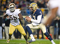 Panthers quarterback Tom Savage (7) runs the ball as Notre Dame Fighting Irish linebacker Prince Shembo (55) pursues in the second quarter.