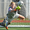 Kaitlyn Larsson #99, Garden City goalie, makes a diving save during a Nassau County Class A varsity girls soccer quarterfinal against North Shore at Garden City High School on Wednesday, Oct. 26, 2016. Garden City won by a score of 1-0.