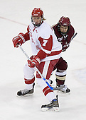 Joe Piskula 7 of the University of Wisconsin and Dan Bertram 22 of Boston College battle for position. The Boston College Eagles defeated the University of Wisconsin Badgers 3-0 on Friday, October 27, 2006, at the Kohl Center in Madison, Wisconsin in their first meeting since the 2006 Frozen Four Final which Wisconsin won 2-1 to take the national championship.<br />