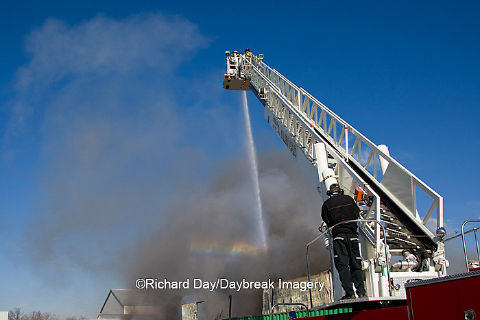 63818-022.06 Firefighters extinguishing warehouse fire using aerial ladder truck, Salem, IL