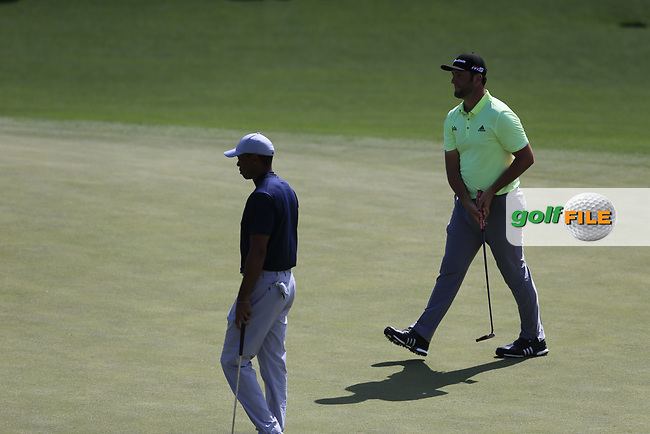 Tiger Woods (USA) and John Rahm (ESP) on the 17th green during the 1st round at the The Masters , Augusta National, Augusta, Georgia, USA. 11/04/2019.<br /> Picture Fran Caffrey / Golffile.ie<br /> <br /> All photo usage must carry mandatory copyright credit (© Golffile | Fran Caffrey)