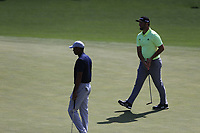 Tiger Woods (USA) and John Rahm (ESP) on the 17th green during the 1st round at the The Masters , Augusta National, Augusta, Georgia, USA. 11/04/2019.<br /> Picture Fran Caffrey / Golffile.ie<br /> <br /> All photo usage must carry mandatory copyright credit (&copy; Golffile | Fran Caffrey)