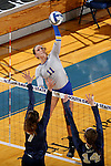BROOKINGS, SD - OCTOBER 28:  Ashley Beaner #11 from South Dakota State tries to get a kill past Laura Milos #7 and Megan Doran #14 from Oral Roberts Friday night at Frost Arena in Brookings. (Photo by Dave Eggen/Inertia)