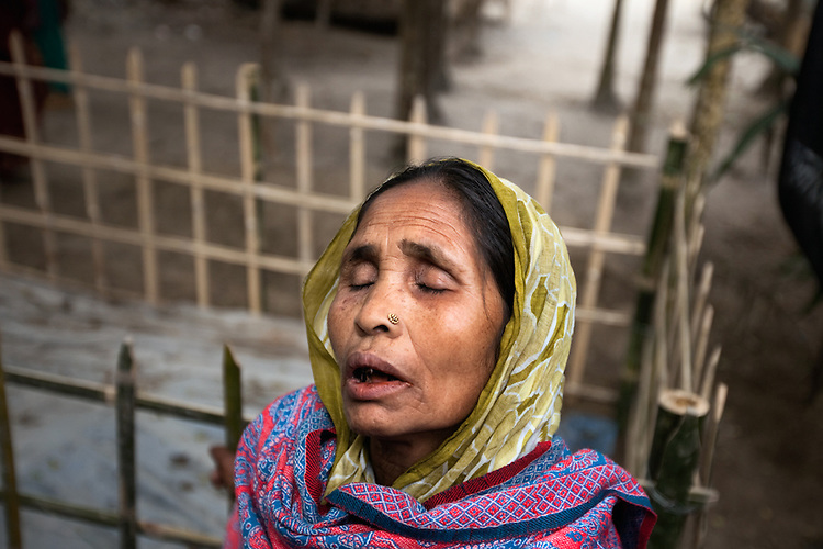 Momena Begum mourns at the grave for her son who was shot by the BSF.
