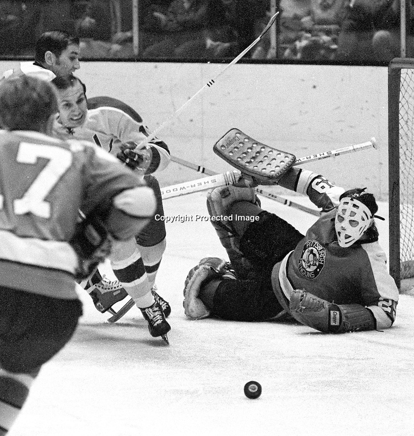 Pittsburg Penguins goalie Al Smith blocks shot from Seal Gary Jarrett..(1971 photo/Ron Riesterer)
