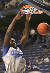 UK forward Patrick Patterson dunks during warm-ups before the Blue and White scrimmage at Rupp Arena Wednesday night. .Photo by Zach Brake | Staff