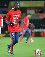 "Modou Barrow of Swansea warms up wearing a ""Show Racism the Red Card"" shirt before the Barclays Premier League match between Swansea City and Stoke City played at the Liberty Stadium, Swansea on October 19th 2015"