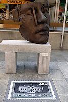 "Liechtenstein  Vaduz  June 2008.A ""African King""   bronze  of Gunther Stilling  in Stadtle street  and stamps."