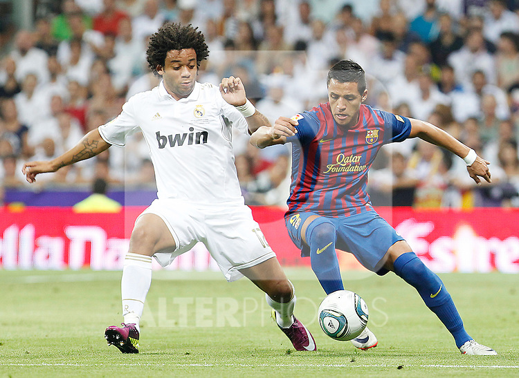 Real Madrid's Marcelo Vieira (l) and FC Barcelona's Alexis Sanchez during Spanish Supercup 1st match.August 14,2011. (ALTERPHOTOS/Acero)