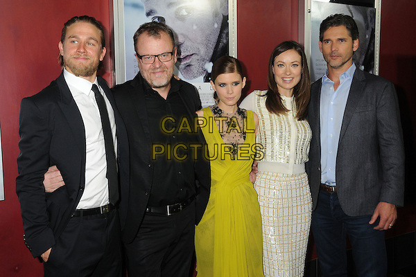 "Charlie Hunnam, Stefan Ruzowitzky, Kate Mara, Olivia Wilde, Eric Bana.Attending the ""Deadfall"" Los Angeles Premiere held at Arclight Cinemas, Hollywood, California, USA, .29th November 2012..half length suit tie yellow chartreuse dress lace cream gold knitted knit cardigan skirt  beard facial hair black glasses shirt smiling .CAP/ADM/BP.©Byron Purvis/AdMedia/Capital Pictures."