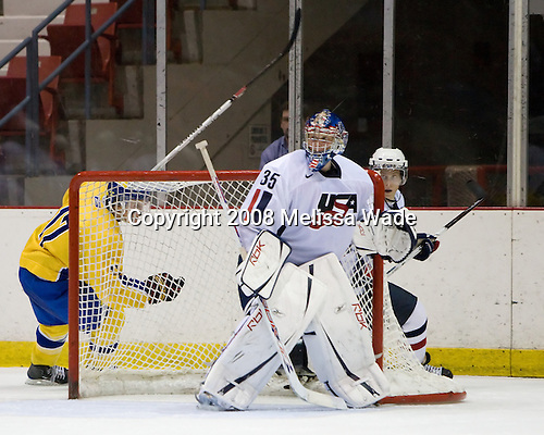 Anton Persson (Sweden 17), Brandon Maxwell (US White - 35), Aaron Ness (US White - 2) - Team Sweden defeated Team USA White 7-3 on Friday, August 8, 2008, in the 1980 Rink during the 2008 US National Junior Evaluation Camp and Summer Hockey Challenge in Lake Placid, New York.
