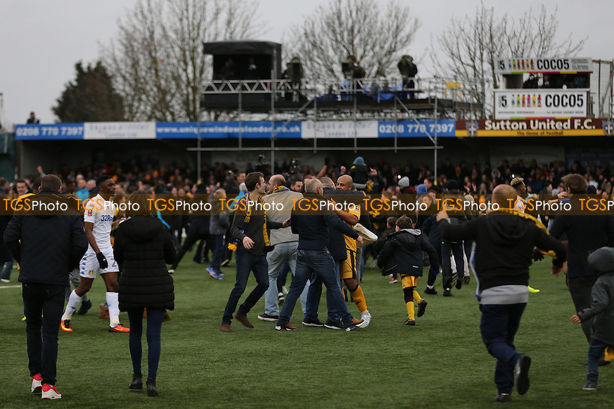 Sutton fans invade the pitch to celebrate their 1-0 Cup victory during Sutton United vs Leeds United, Emirates FA Cup Football at the Borough Sports Ground on 29th January 2017