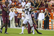 Landover, MD - September 3, 2017: West Virginia Mountaineers cornerback Mike Daniels Jr. (4) breaks up a pass during game between Virginia Tech and WVA at  FedEx Field in Landover, MD.  (Photo by Elliott Brown/Media Images International)