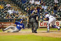 Las Vegas 51s third baseman Chris Woodward #5 looks to the home plate umpire after sliding home during the Pacific Coast League baseball game against the Round Rock Express on August 7th, 2012 at the Dell Diamond in Round Rock, Texas. Woodward was called out on the play. The Express defeated the 51s 5-4. (Andrew Woolley/Four Seam Images).