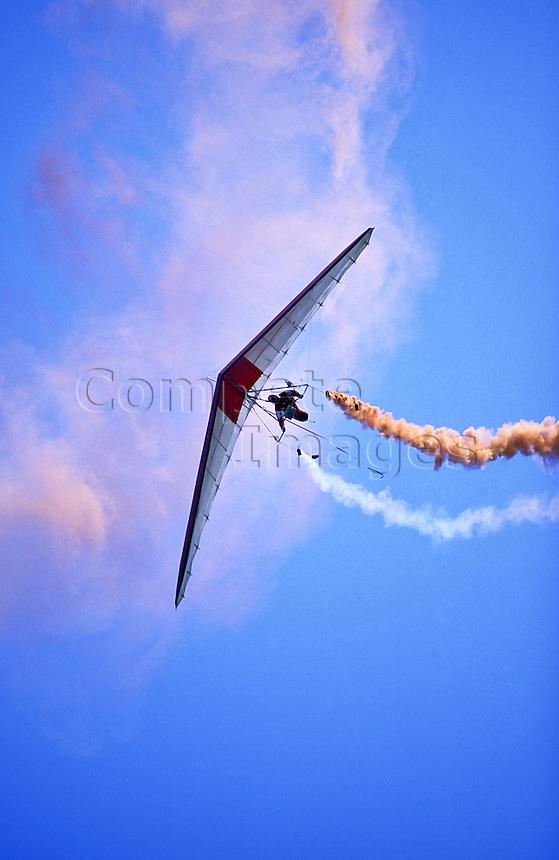 Hang glider streaming smoke