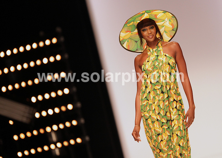 **ALL ROUND PICTURES FROM SOLARPIX.COM**.**NO UK NEWSPAPER PUBLICATION**.**UK MAGAZINE & SUPPLEMENT PUBLICATION ONLY** AND NO PUBLICATION IN AUSTRALIA, GERMANY, ITALY, SCANDINAVIA and USA** .Naomi Campbell models in the Issa London catwalk show, London, UK, as part of London Fashion Week 2009. 20 September 2009..This pic: Naomi Campbell..JOB REF: 9985 SFE       DATE: 20_09_2009.**MUST CREDIT SOLARPIX.COM OR DOUBLE FEE WILL BE CHARGED**.**MUST NOTIFY SOLARPIX OF ONLINE USAGE**.**CALL US ON: +34 952 811 768 or LOW RATE FROM UK 0844 617 7637**