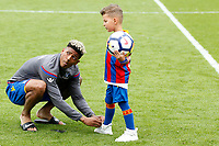 Patrick van Aanholt of Crystal Palace does up his son's shoe during the EPL - Premier League match between Crystal Palace and West Bromwich Albion at Selhurst Park, London, England on 13 May 2018. Photo by Carlton Myrie / PRiME Media Images.