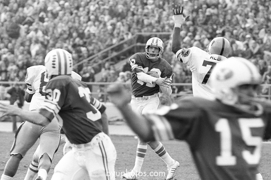 FTB 79 C 38 Arizona State<br /> <br /> Football BYU vs Arizona State, First win over ASU in history of school. 12 Gary Sheide Quarter Back. 30 Jeff Blanc.<br /> <br /> November 9, 1974<br /> <br /> Box Number: In office<br /> <br /> Photo by: Mark Philbrick/BYU<br /> <br /> Copyright BYU PHOTO 2008<br /> All Rights Reserved<br /> 801-422-7322<br /> photo@byu.edu