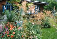 Mixed border with grasses, and containers; Roger Raiche Berkeley Maybeck Cottage garden