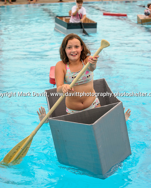 Indianola Park and Recreations hosted cardboard boat races at the Veteran's Memorial Aquatic Center July 22. Maggie Buttrey was busy rowing with a little guiding hands from a life guard.