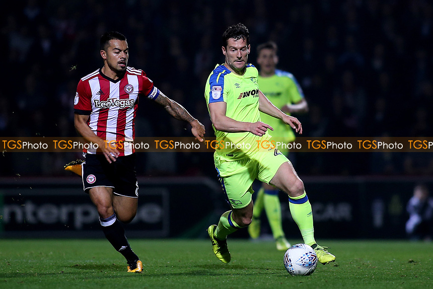 Kevin Nugent of Derby County in possession as Brentford's Nico Yennaris looks on during Brentford vs Derby County, Sky Bet EFL Championship Football at Griffin Park on 26th September 2017
