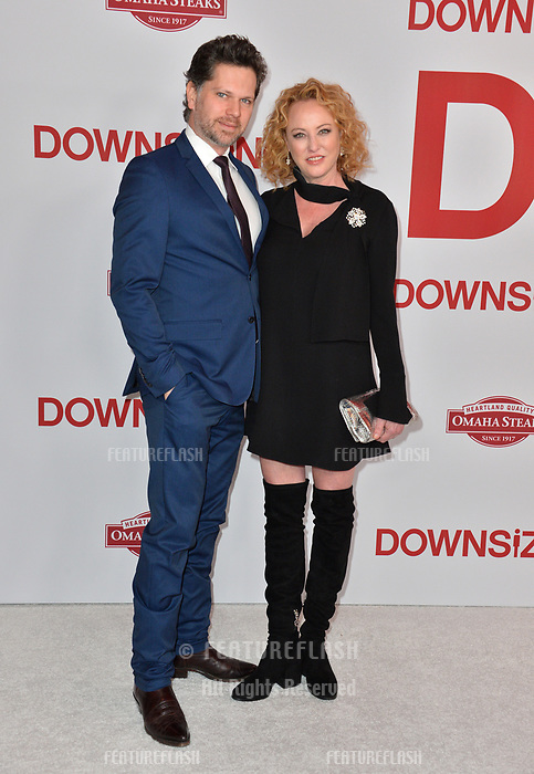 Virginia Madsen &amp; Nick Holmes at the special screening of &quot;Downsizing&quot; at the Regency Village Theatre, Westwood, USA 18 Dec. 2017<br /> Picture: Paul Smith/Featureflash/SilverHub 0208 004 5359 sales@silverhubmedia.com