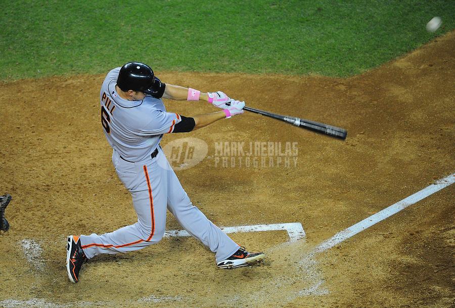 May 13, 2012; Phoenix, AZ, USA; San Francisco Giants batter Brett Pill hits a two run home run in the fifth inning against the Arizona Diamondbacks at Chase Field. Mandatory Credit: Mark J. Rebilas-