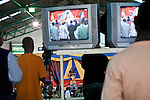 The overflow crowd watches a video feed of Pastor David Adeoye during Easter Sunday services at Nairobi's Winner's Chapel, a fast growing evangelical Christian Church, founded in Nigeria.