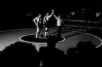 Mesa State's 285-pound Brandon Alexander, left, look onto a group of fans after defeated by fall 6-0 against Steve Franklin, right, of San Francisco State Thursday evening Jan. 10 at the SF State Main Gymasium.
