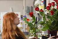 Kristyne (cq) Marveggio, a floral designer at the Springdale Flower Shop, puts together and arrangement of long stem roses Wednesday, February 12, 2020, for a Valentines delivery at the florist shop in Springdale. Owner Rusty Eldridge said that roses and lilies remain the favorite for Valentine's Day. Check out nwaonline.com/200213Daily/ and nwadg.com/photos for a photo gallery.<br /> (NWA Democrat-Gazette/David Gottschalk)