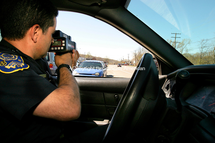 WATERTOWN, CT--03 MAY 2007--050307JS05- Waterbury police officer Lee Santos uses a laser gun to check for speeders on South Main Street in Waterbury on Wednesday. The police department has stepped up traffic enforcement as part of a push in quality-of-life-crimes. <br /> Jim Shannon/Republican-American