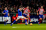 Inigo Martinez of Athletic de Bilbao (L)  fights for the ball with Angel Correa of Atletico de Madrid during the La Liga 2018-19 match between Atletico de Madrid and Athletic de Bilbao at Wanda Metropolitano, on November 10 2018 in Madrid, Spain. Photo by Diego Gouto / Power Sport Images