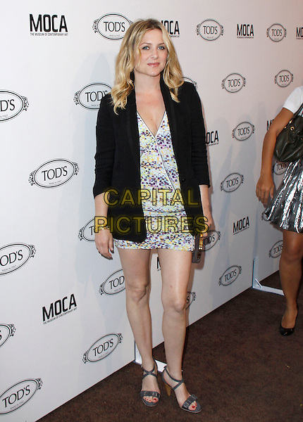JESSICA CAPSHAW.The Diego Della Valle Cocktail Celebration Honoring Tod's Beverly Hills Boutique And MOCA's New Director Jerry Deitch at Tod's Boutique in Beverly Hills, California, USA..April 15th, 2010        .full length black jacket blazer white blue green yellow print mini dress grey gray sandals open toe clutch bag.CAP/RKE/DVS.©DVS/RockinExposures/Capital Pictures.