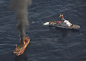 The Japanese fishing vessel Ryou-Un Maru burns after the Coast Guard Cutter Anacapa crew fired explosive ammunition at the vessel in the Gulf of Alaska 180 miles west of the Southeast Alaskan coast April 5, 2012. The Coast Guard worked closely with federal, state and local agencies to assess the immediate dangers the vessel presented and determined that sinking the vessel at sea would be the best course of action to help minimize any navigation and environmental threats. .Mandatory Credit: Charly Hengen / USCG via CNP