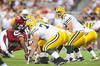Aug. 28, 2009; Glendale, AZ, USA; Green Bay Packers quarterback (12) Aaron Rodgers prepares to take the snap against the Arizona Cardinals during a preseason game at University of Phoenix Stadium. Mandatory Credit: Mark J. Rebilas-