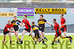 Gavin O'Shea and Alan O'Sullivan Dr Crokes tackles track Griffin Wharton Kenmare Shamrocks during their SFC QF in Fitzgerald Stadium on Sunday